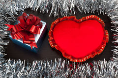 Valentine gift box with heart shape toy on wooden background wit. H festive glitter Stock Image