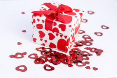 Valentine gift. Gift box with red hearts Stock Photos