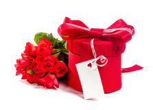 Valentine gift box and red roses bouquet Royalty Free Stock Photography