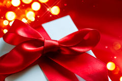 Valentine gift box on red silk background Royalty Free Stock Photos