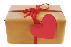 Valentine gift, brown paper parcel, red heart shape gift tag Stock Photography