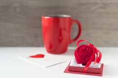 Valentine gift with greeting card and red cup. Valentine gift box with greeting card and red cup on wooden background. Close-up Stock Images
