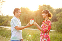 Valentine gift. Happy couple in love together. Outdoors Royalty Free Stock Photos