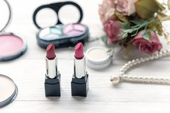 Valentine Gift. Makeup cosmetics tools background and beauty cosmetics, products and facial cosmetics package lipstick with pink r stock photos