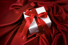 Valentine gift on red satin Stock Images