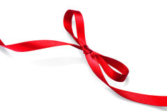 Valentine gift red tape bow. Elegant red satin gift ribbon royalty free stock photos