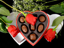 Valentine Gift & Roses. A box of Valentine candy and some roses stock image