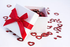 Valentine gift. White gift box with red hearts Royalty Free Stock Photography