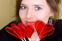 Valentine girl. Is holding lollipops in palm Stock Photos