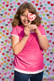 Valentine girl with lollipop Stock Images