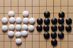 Valentine Go game. Two hearts of black and white stones are on a goban Stock Photo