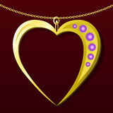 Valentine gold pendant gift. Valentine gold necklace, heart pendant with gems on dark background Royalty Free Stock Photos