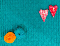 Valentine green knitted background with hearts Stock Image