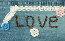 Valentine, greeting card with coffee beans and knitted flowers. Royalty Free Stock Images