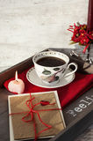 Valentine greeting card and cup on wooden tray. Valentines day gif card and cup of coffee on wooden tray Royalty Free Stock Photography