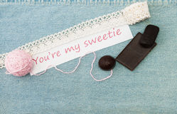 Valentine greeting card with ravel, chokolate and  lettering Yo Royalty Free Stock Photography
