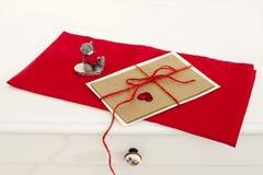 Valentine greeting card on red napkin. Valentine's day greeting card on red background Royalty Free Stock Photo