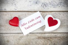 Valentine greeting card on wooden table with text Alles Liebe zum Valentinstag, written in German, which means Happy Valentine da. Y in English stock photography