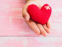 Valentine, health, medicine and charity concept.  heart on aging. Kid hand support Royalty Free Stock Photo