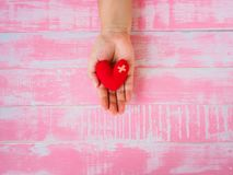 Valentine, health, medicine and charity concept.  heart on aging. Kid hand support Stock Photography