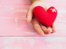 Valentine, health, medicine and charity concept.  heart on aging. Kid hand support Royalty Free Stock Images