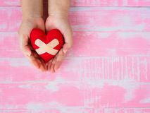 Valentine, health, medicine and charity concept.  heart on aging. Kid hand support Stock Images