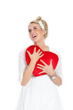 Valentine heart. Pretty blond woman looking heavenly with a big red heart Royalty Free Stock Images