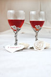 Valentine heart. Two beautiful glasses with red napkin, heart and rose Stock Photography