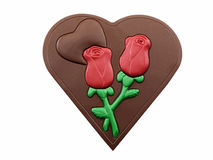 Valentine Heart. Photo of a chocolate heart with two chocolate red roses, isolated on a white background Royalty Free Stock Photography