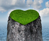 Valentine Heart. Shaped mountain cliff island surrounded by water as a lonely and romantic symbol of the challenges of dating and searching for a loving Royalty Free Stock Photo