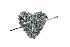 Valentine heart with arrow of screws, washers Stock Photography