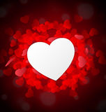 Valentine heart as paper in front of red little hearts Royalty Free Stock Photos