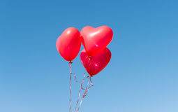 Valentine heart balloon against blue sky Royalty Free Stock Photos