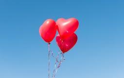 Valentine heart balloon against blue sky Royalty Free Stock Photos