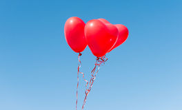 Valentine heart balloon against blue sky Stock Photography