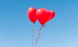 Valentine heart balloon against blue sky Stock Photos