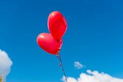 Valentine heart balloon on blue sky background Stock Photo