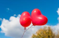 Valentine heart balloon on blue sky background Stock Photography