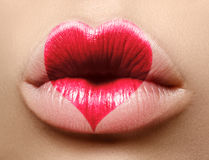 Valentine Heart on beautiful female Lips. Sweet Kiss. Love Makeup for Valntines Day. Cute Shape Heart. Love Symbol Royalty Free Stock Image