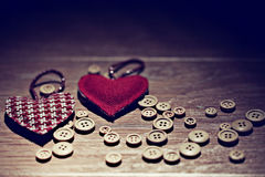 Valentine heart among buttons Stock Photography