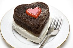 Valentine Heart Cake. A heart shaped chocolate cake on plate with fork Stock Images
