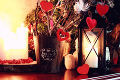 Valentine heart candle toy. Different objects with holiday decor on a color background stock images