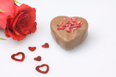 Valentine heart of chocolate. Red rose with a chocolate heart and red hearts romantic concept Stock Images