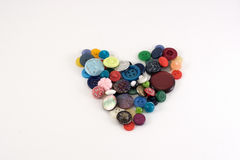 Valentine Heart of color buttons. Various sewing buttons set Stock Image