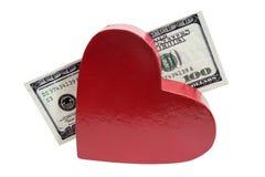 Valentine Heart con cientos dólares Fotos de archivo libres de regalías