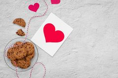 Valentine heart cookies with greeting card on stone table, top v. Iew Royalty Free Stock Photo