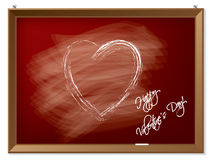 Valentine heart drawn on red chalkboard Stock Image