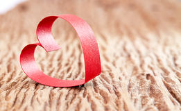 Valentine Heart. Elegant Red Satin Gift Ribbon royalty free stock photo