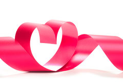 Valentine Heart. Elegant Red satin gift Ribbon. Stock Photo