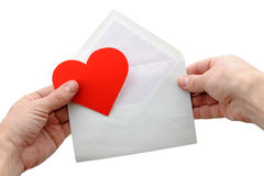 Valentine heart and envelope in hands. On white background Stock Image